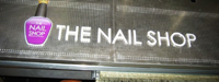 The nail shop sign
